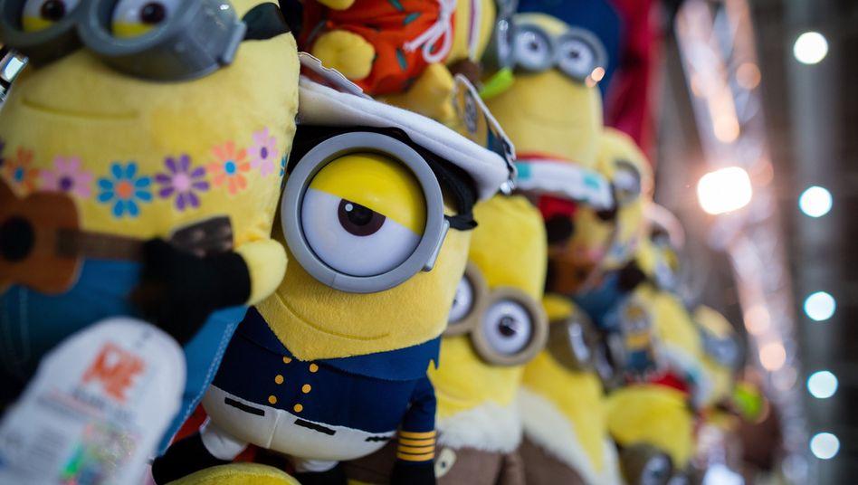 Minions-Plüschfiguren an einem Messestand: 14,3 Millionen Euro sollen NBC Universal und weitere Firmen der Comcast-Gruppe zahlen