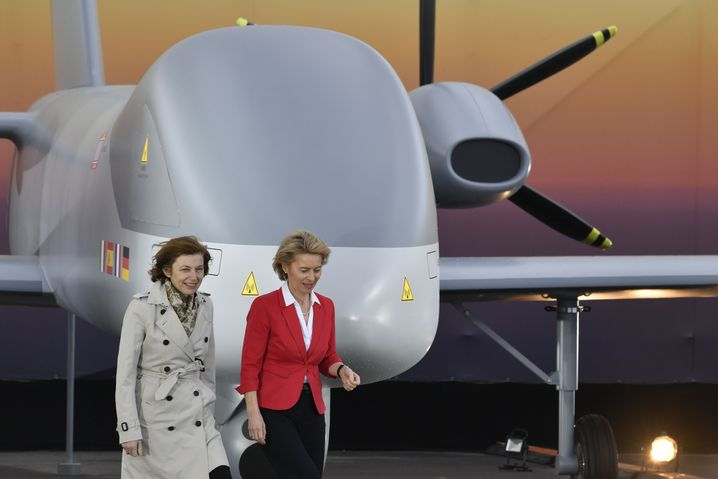 German Defense Minister Ursula von der Leyen (right) and her French counterpart Florence Parly pose next to a drone made by a consortium of European aerospace contractors.