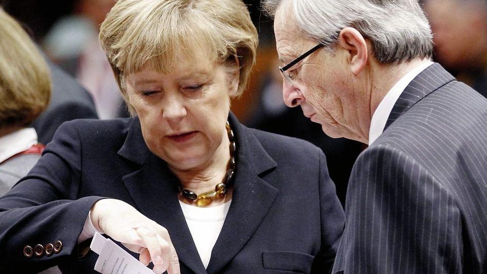 Kanzlerin Merkel, Euro-Gruppen-Chef Juncker