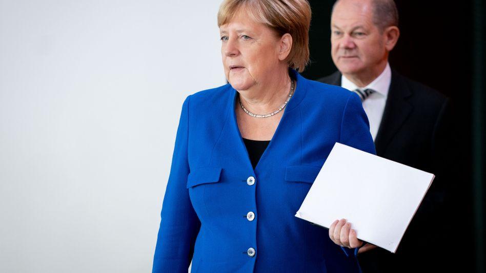 Kanzlerin Merkel (CDU), Finanzminister Scholz (SPD): Wie reagiert die Unionsfraktion?