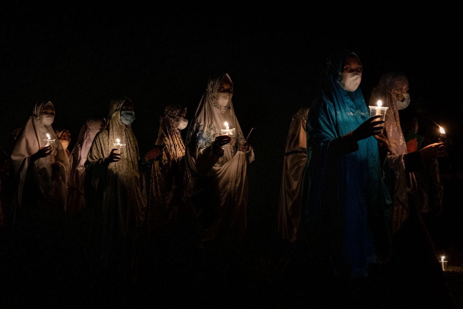 Indonesian Muslims Read Koran By Candlelight