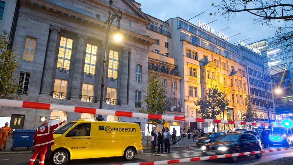 Geldtransporter und Polizisten im Jahr 2014 auf dem Kurfürstendamm in Berlin: Maskierte erbeuteten Bargeld in Höhe von mehr als 600.000 Euro