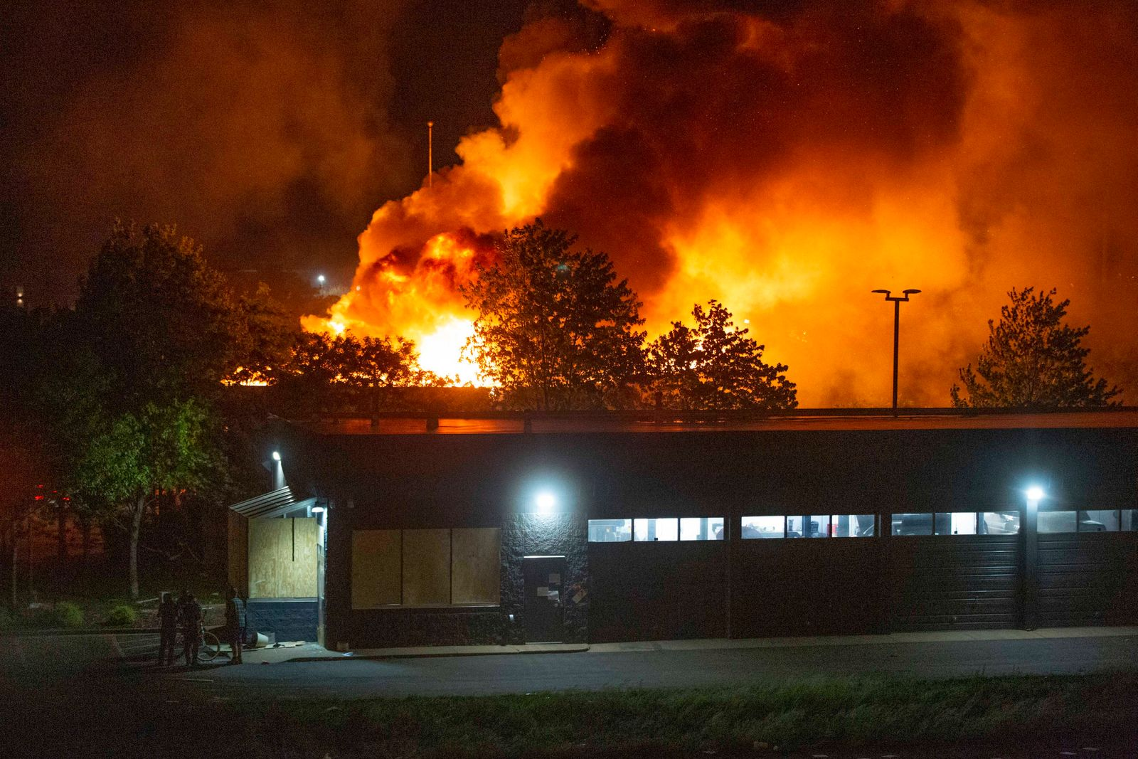 May 29, 202, Minneapolis, Minnesota, USA: A fire burns in the distance while riots and looting break out across the cit