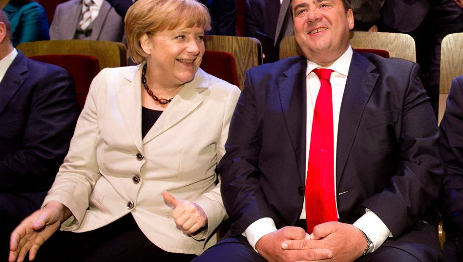 Grand coalition soon? Merkel sharing a joke with Sigmar Gabriel, the leader of the SPD.