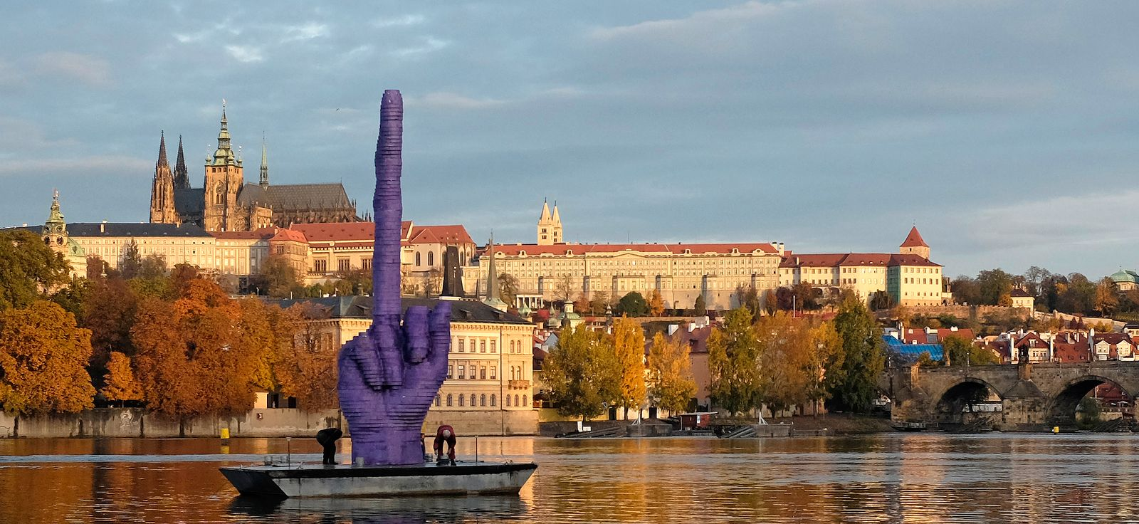 Workers anchor a boat bearing an installation work by Czech visual artist David Cerny in front of the Prague Castle in Prague