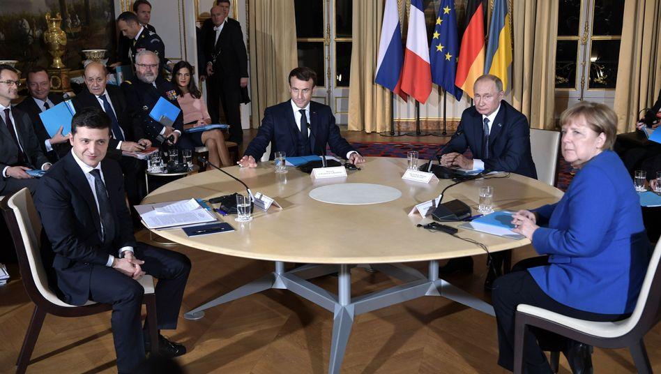Gipfeltreffen in Paris mit (v.l.) Selenskyj, Macron, Putin und Merkel: Es war das erste Mal, dass sich die Präsidenten Russlands und der Ukraine persönlich trafen
