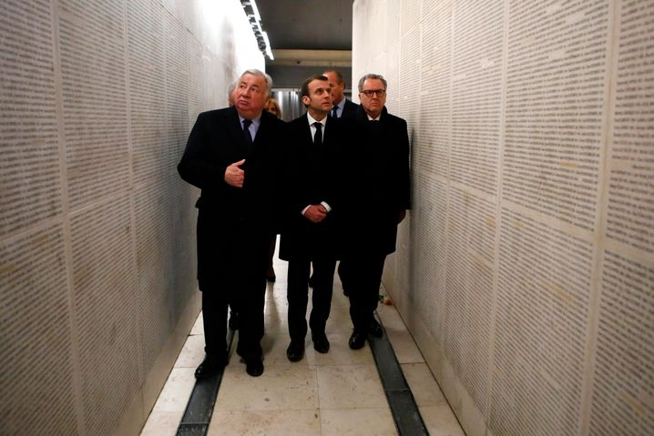 French President Emmanuel Macron, center, visiting the Shoah Memorial in Paris.