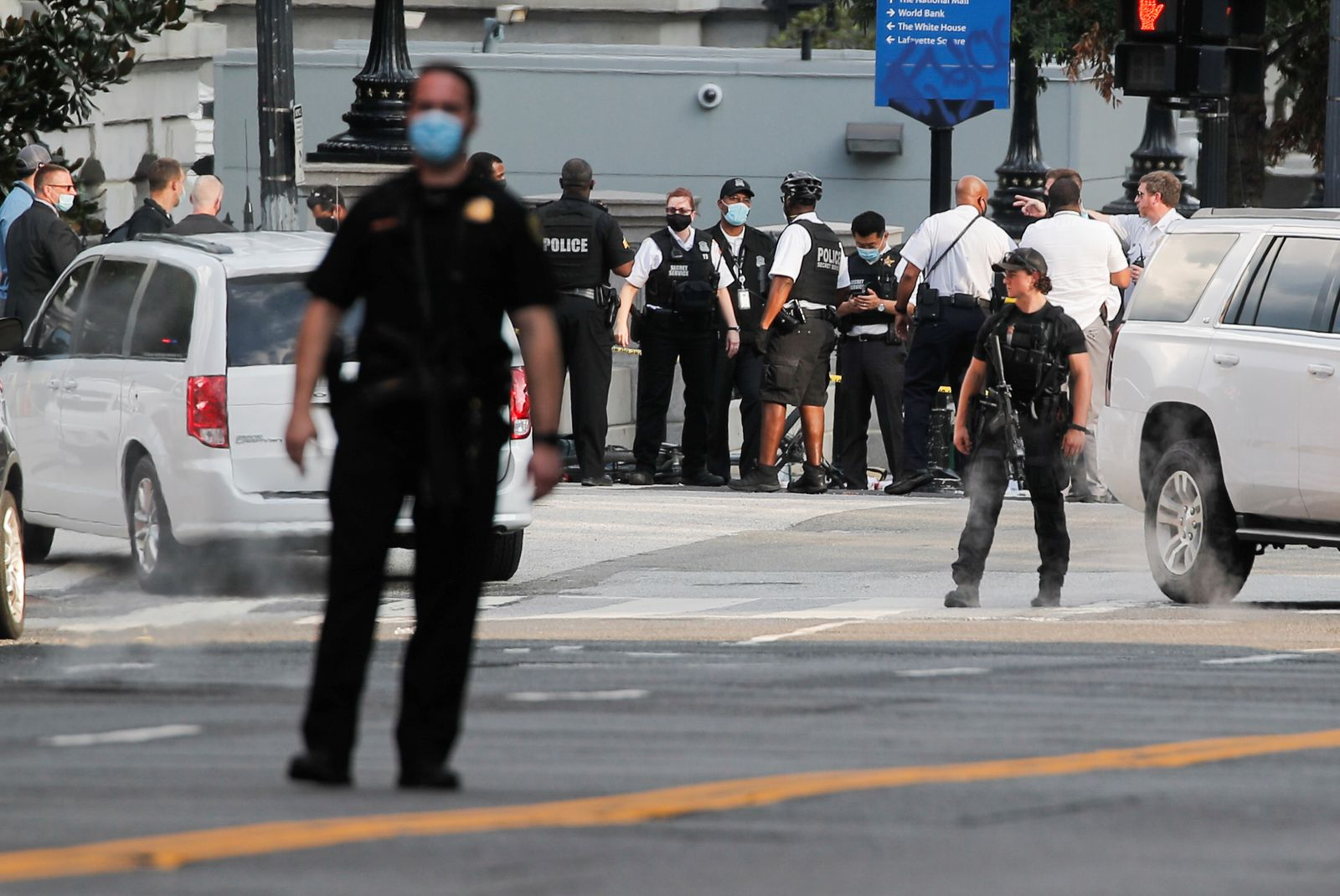 Police officers stand guard at the corner of 17th Street and Pennsylvania Avenue, near the White House, in Washington