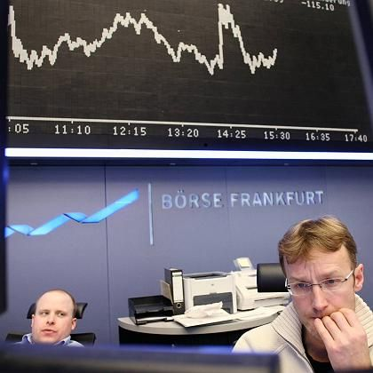 Anxious traders watching the market at the Frankfurt Stock Exchange on Tuesday.