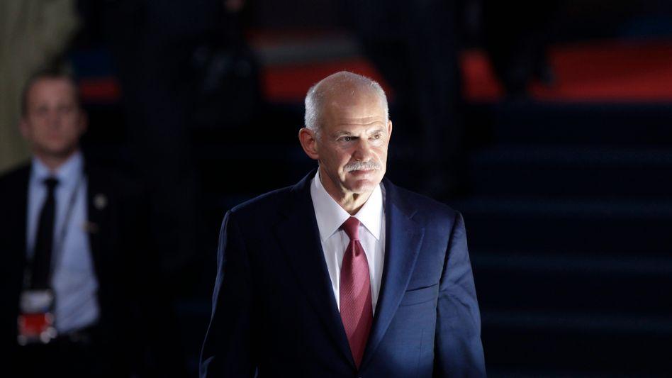 Griechenlands Premier Papandreou: Öffentlichkeit beruhigen, Neuwahlen verhindern