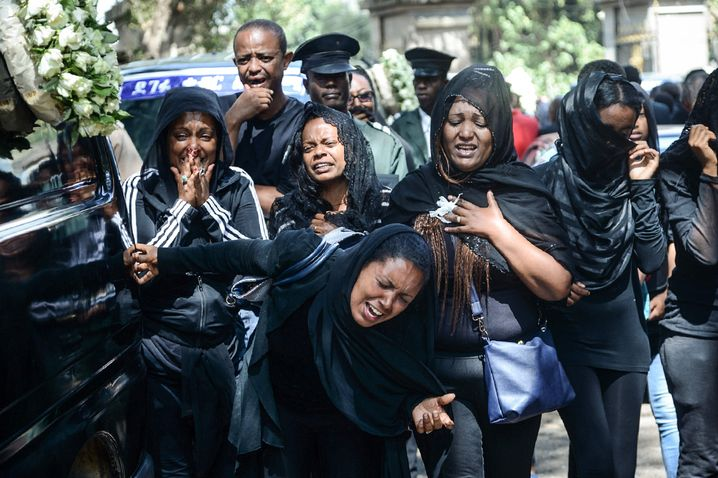 Mourners at the mass funeral in Addis Ababa for the victims of the Ethiopian Airlines crash: The coffins buried contained only soil, and it will be months before the identities of the remains have been determined.