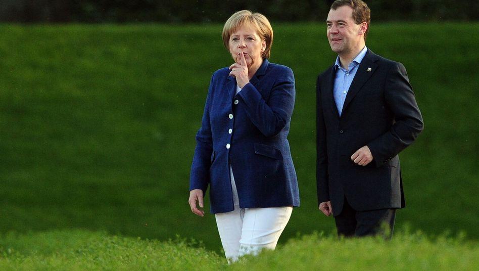 Kanzlerin Merkel: Millionen hier, Milliarden dort