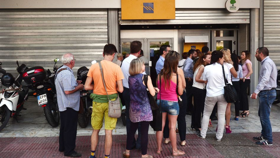 People in Athens line up in front of a shuttered bank to withdraw money from an ATM machine. This weekend, the Greek government imposed capital controls and closed banks in order to stop the flight of money from the country.