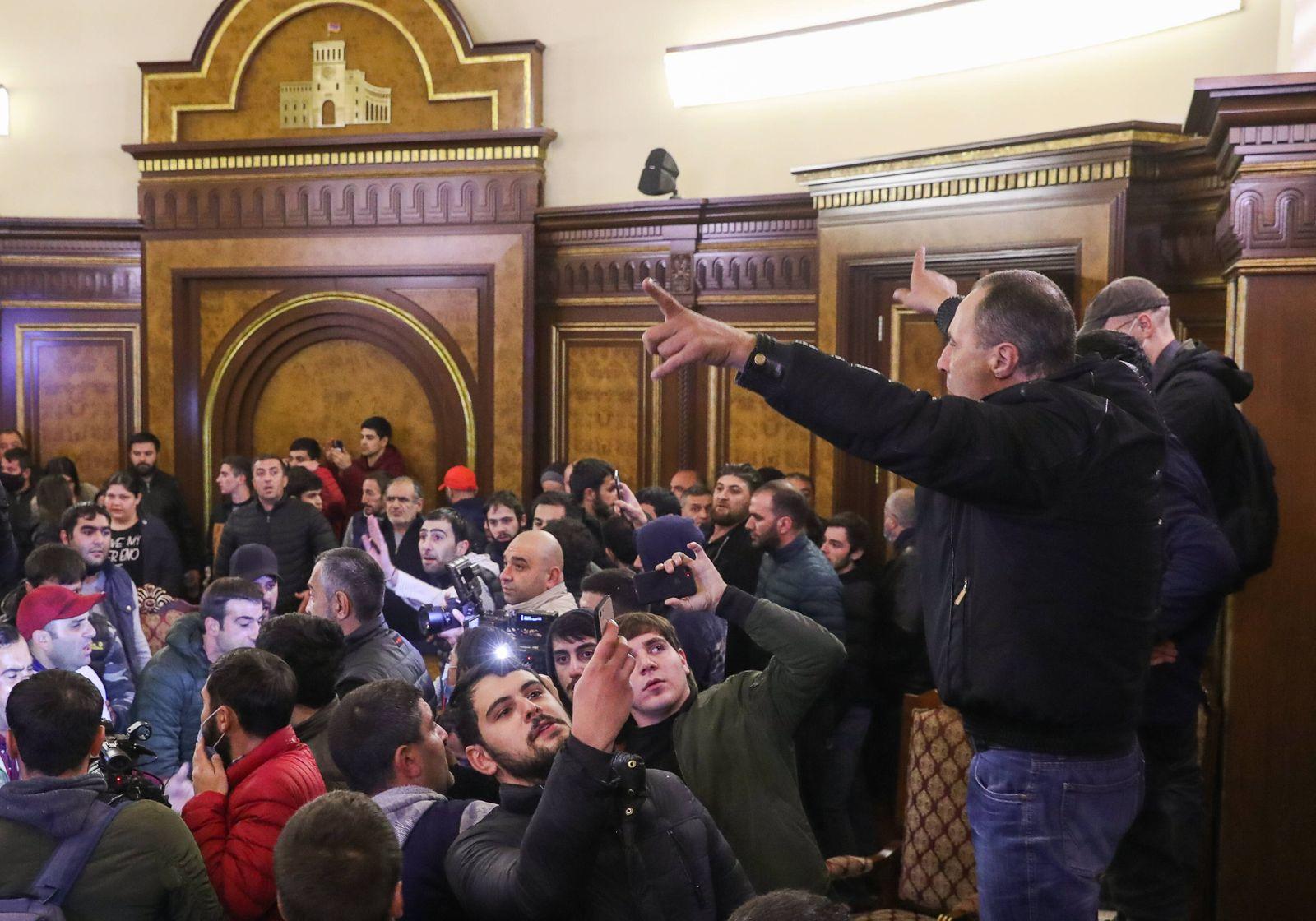 YEREVAN, ARMENIA - NOVEMBER 10, 2020: Demonstrators protesting against the end of war in Nagorno Karabakh break into th
