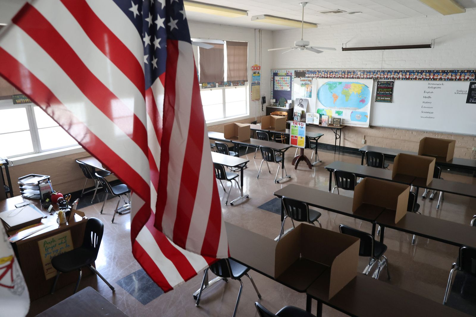 Social distancing dividers for students are seen in a classroom at St. Benedict School, amid the outbreak of the coronavirus disease (COVID-19), in Montebello, near Los Angeles