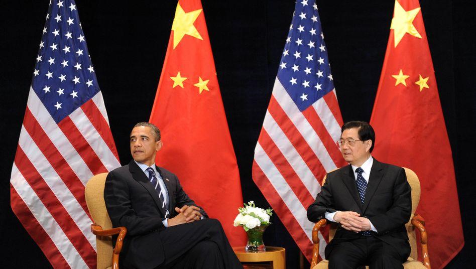 Rivalen Obama, Hu (in Seoul): Der eine erzählt Anekdoten, der andere lässt Brücken bauen