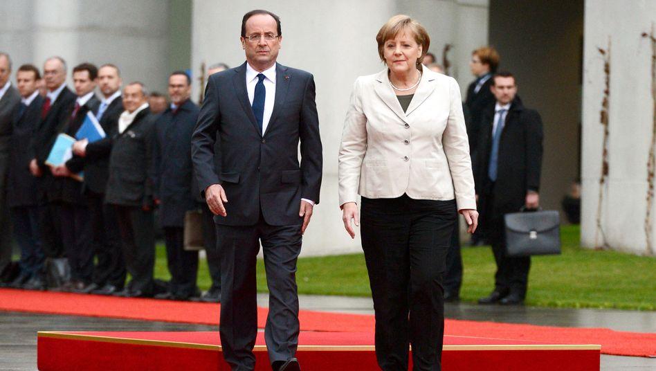 """Hollande, Merkel (im Mai in Berlin): """"Den Verpflichtungen nachkommen"""""""