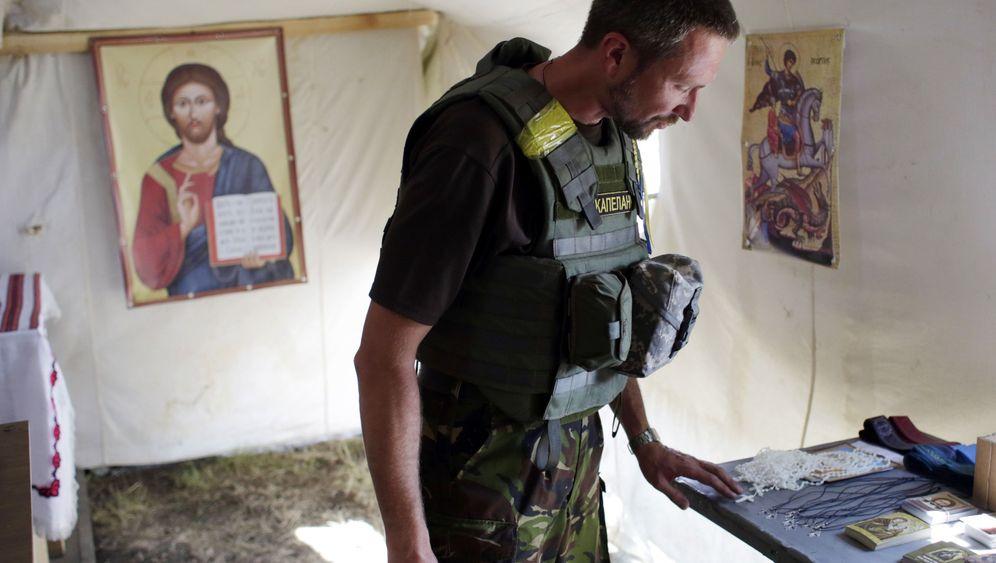 Kämpfe in Donezk: Beten und schießen