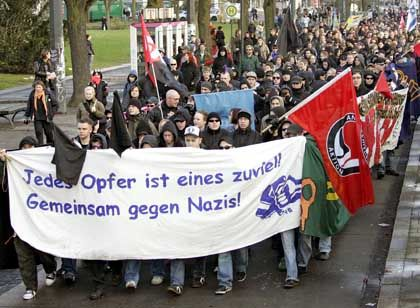 """Demonstrators protest against Sunday's attack on an Ethiopian-born German in Potsdam, eastern Germany. Banner reads """"Every Victim is One Victim Too Many. United Against Nazis"""