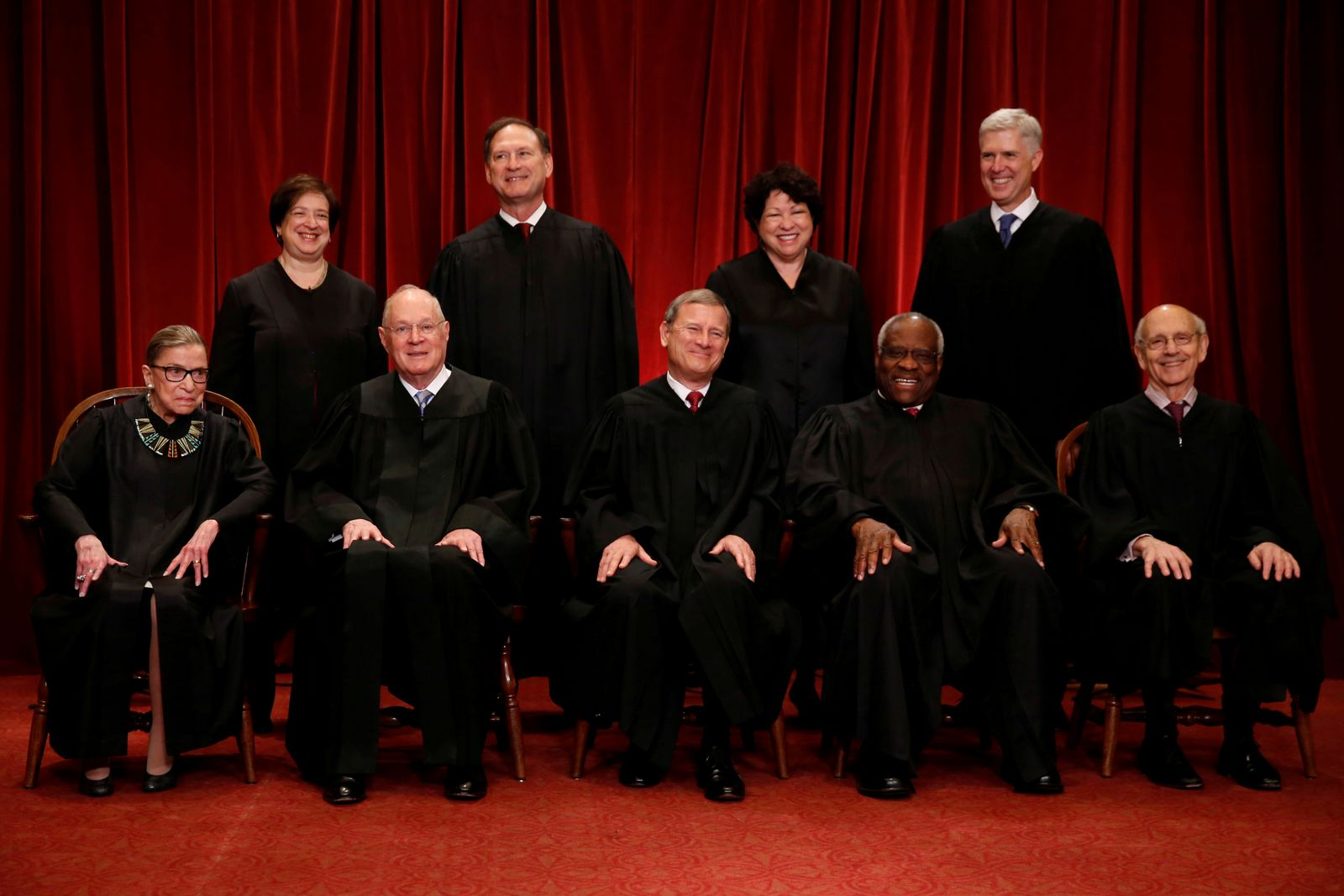 FILE PHOTO: Roberts leads the U.S. Supreme Court in taking a new family photo including Gorsuch, their most recent addition, at the Supreme Court building in Washington