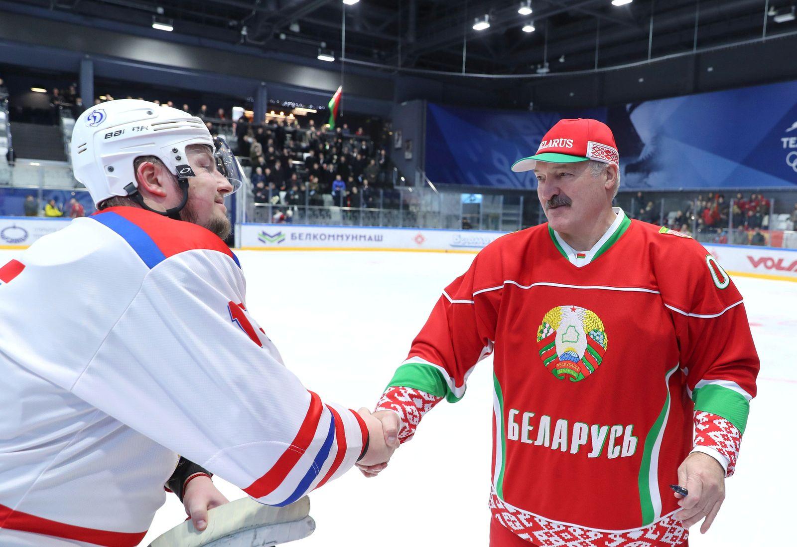 Belarusian President Alexander Lukashenko takes part in an amateur ice hockey game in Minsk