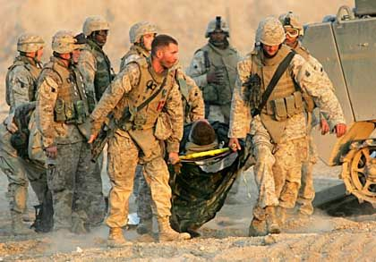 An injured soldier is rescued in Iraq: Bullet-proof vests only protect the heart.