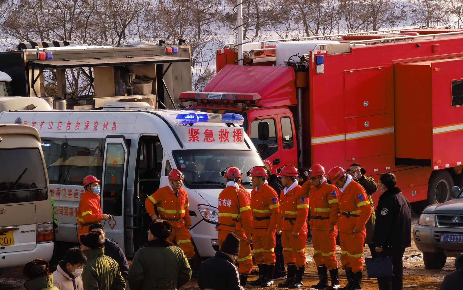 (210112) -- QIXIA, Jan. 12, 2021 -- Rescuers are seen at the explosion site of a gold mine in Qixia City, east China s