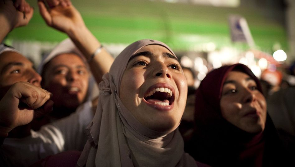 Supporters of the Islamist Ennahda party celebrate their election victory.