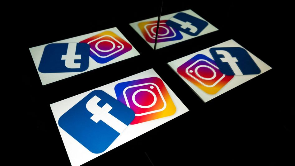 Die Logos von Instagram und Facebook auf einem Tablet und einem Smartphone