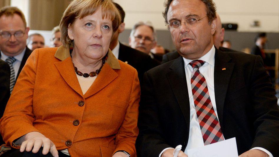 Bundeskanzlerin Merkel, Bundesinnenminister Friedrich:Mit Schildkrötentaktik