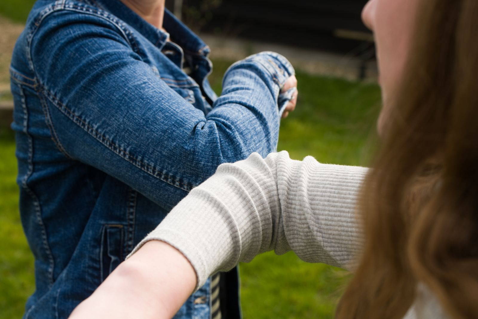 Alternative handshake. Bumping elbow to say hello. Corona Covid-19 meeting.
