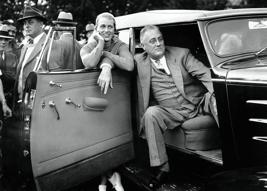 President Franklin Delano Roosevelt during a visit to a baseball game with his daughter Anna Boettiger in Quaker Hill, New York, in 1935.