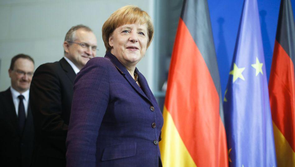 Bundeskanzlerin Merkel mit Beratern: Rückwärtsgewandte Wirtschaftspolitik