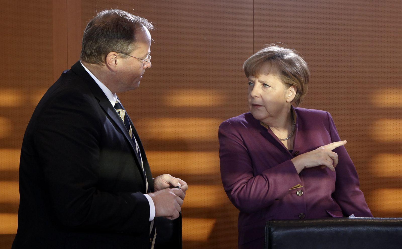 Niebel / Merkel