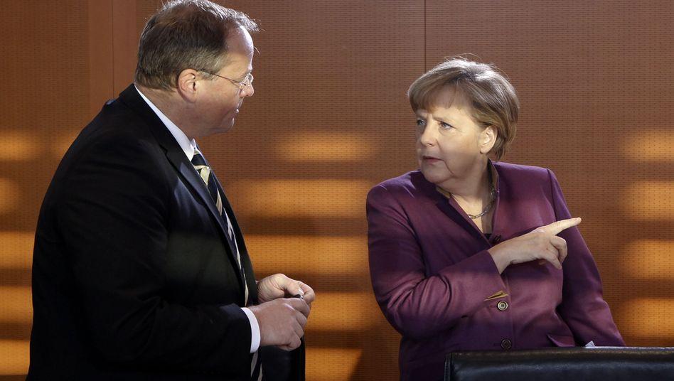 Damaliger Minister Niebel und Kanzlerin Merkel (Bild von 2012): Karenzzeit von einem Jahr gefordert