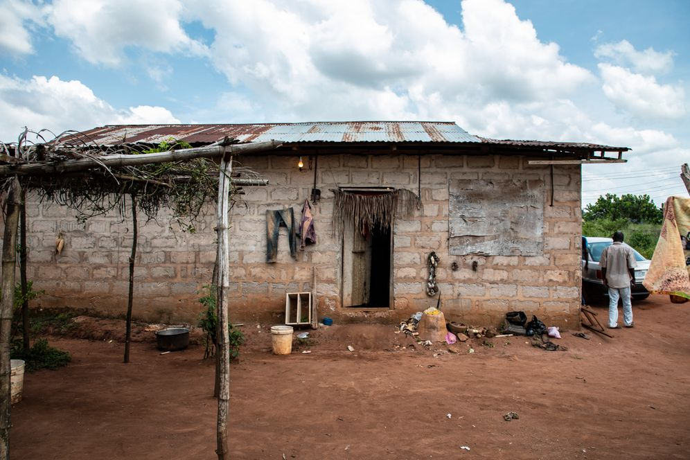 Inside this building in Benin City, Nigeria, a priest performs Juju-rituals