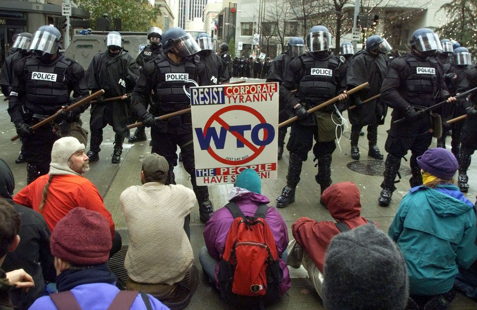 PROTESTERS BLOCK POLICE LINE AT WTO CONFERENCE