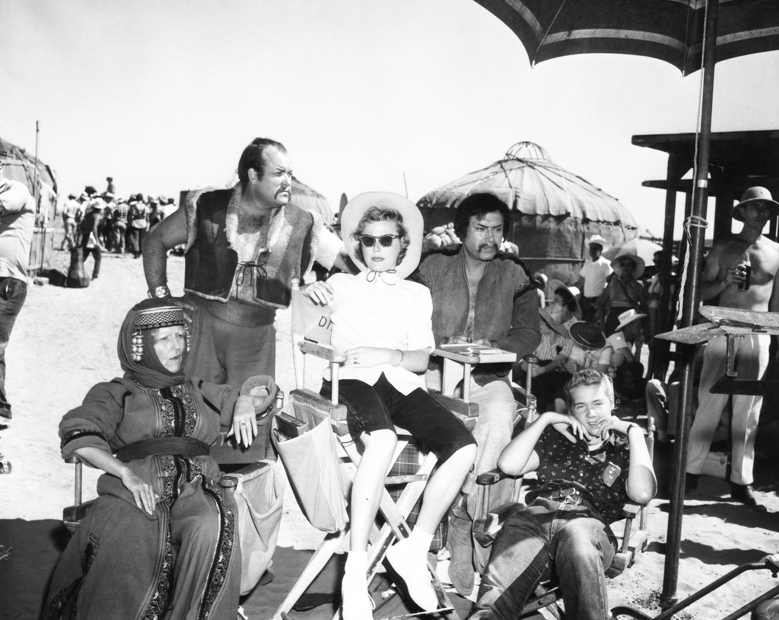 THE CONQUEROR, on location near St. George, Utah, from second left, William Conrad, director's