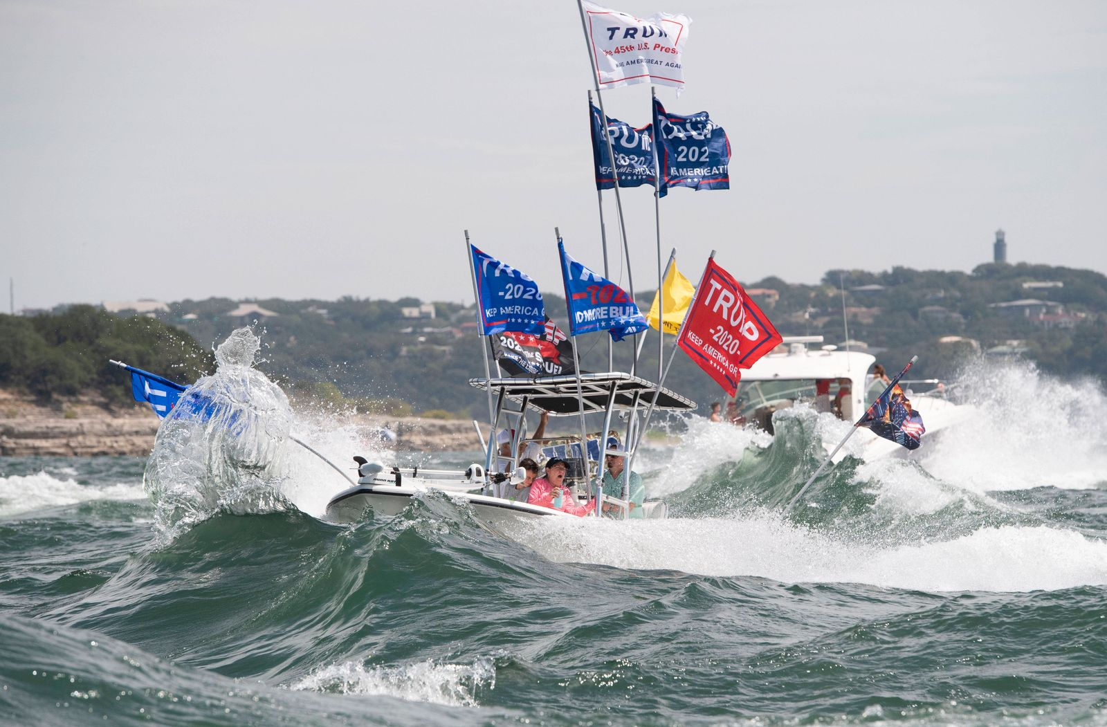 September 5, 2020, Lakeway, Texas, USA: Boats flying flags honoring President Donald Trump crowd Lake Travis during a bo