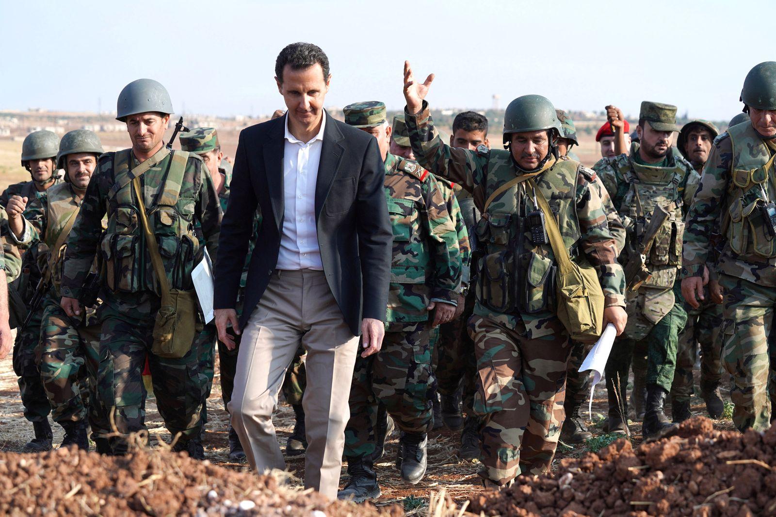 Syrian President Bashar al Assad visits Syrian army troops in war-torn northwestern Idlib province