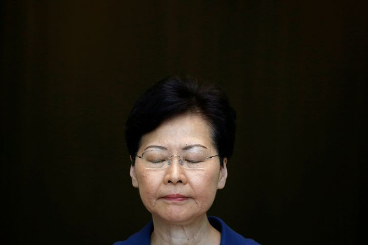 "Hong Kong Chief Executive Carrie Lam at a press conference on Tuesday at which she warned against falling ""further into the abyss."""
