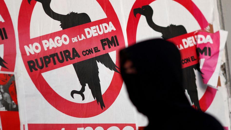 Protestplakat gegen IWF in Buenos Aires (im Mai): endlich eine Einigung