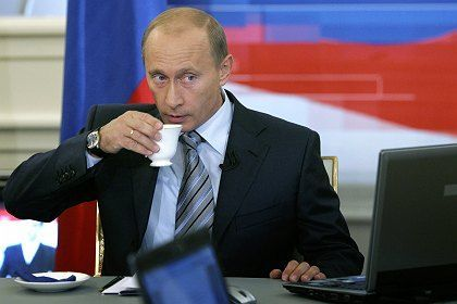 """President Vladimir Putin as he listens to a question during a call-in show on Russian TV. He announced """"grandiose"""" plans for Russia's military during the show."""
