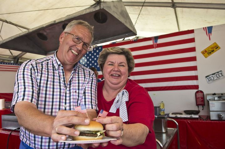 Richard Simmons and his wife Irene operate a hamburger stand at the German-American Fair in Berlin, a carnival that has seen better days.
