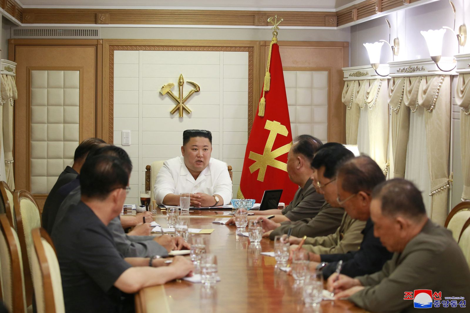 North Korea's leader Kim attends a meeting in Pyongyang
