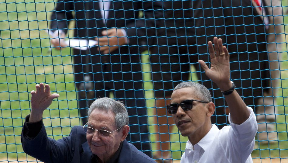 US President Barack Obama (right) and his Cuban counterpart Raul Castro at a baseball game between the Tampa Bay Rays and the Cuban national baseball team in Havana.