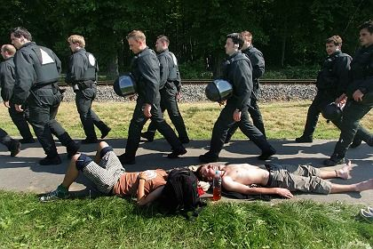 Police walk by sleeping demonstrators near Bad Doberan on Thursday morning.