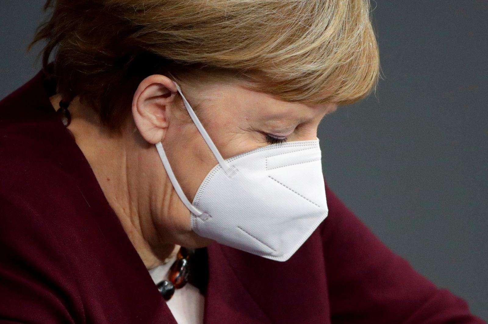 FILE PHOTO: German Chancellor Angela Merkel delivers a speech on the government's response to the coronavirus disease (COVID-19) pandemic in Berlin