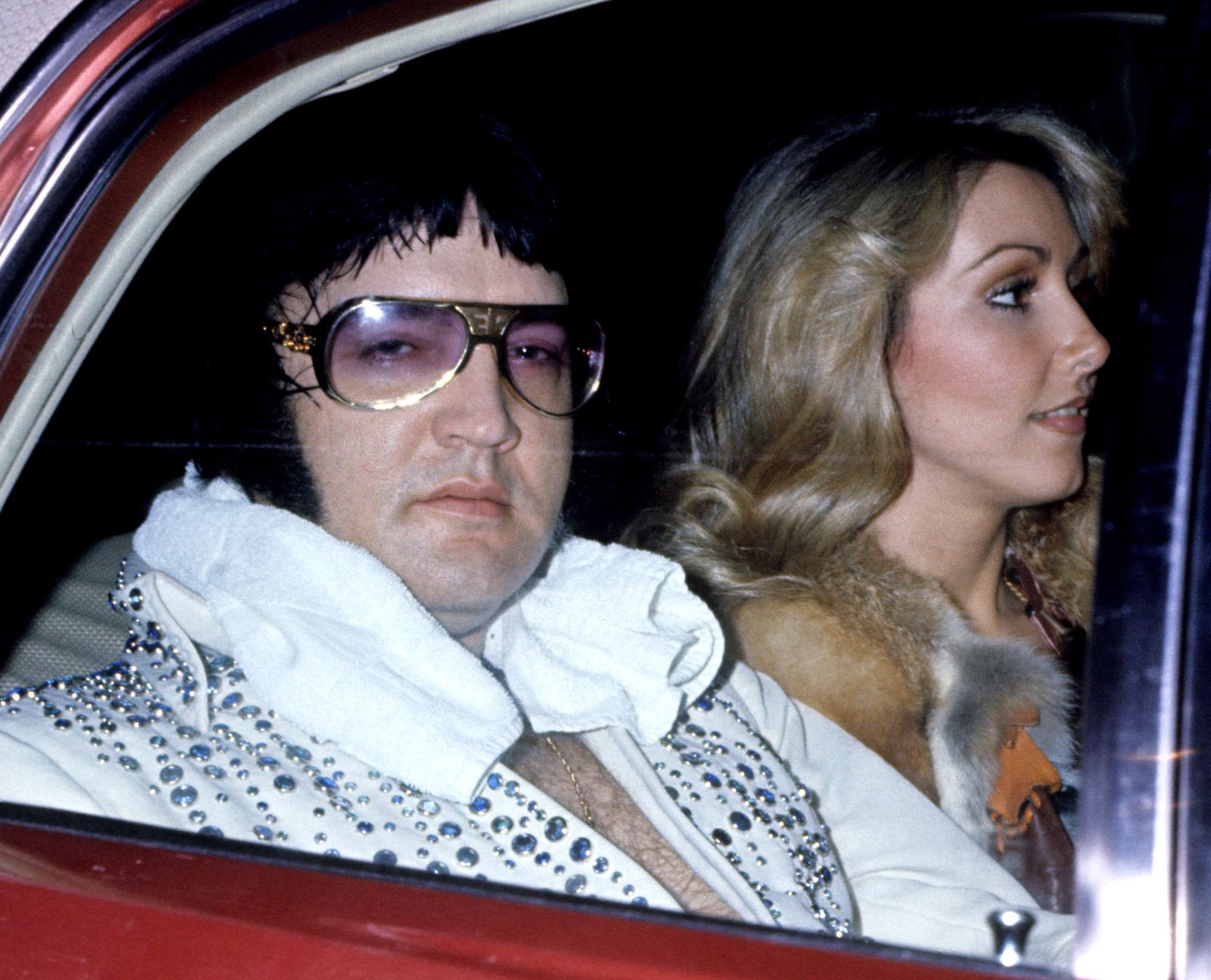 Elvis Presley With Girlfriend Linda Thompson Arrive At Hotel After Concert - March 21, 1976