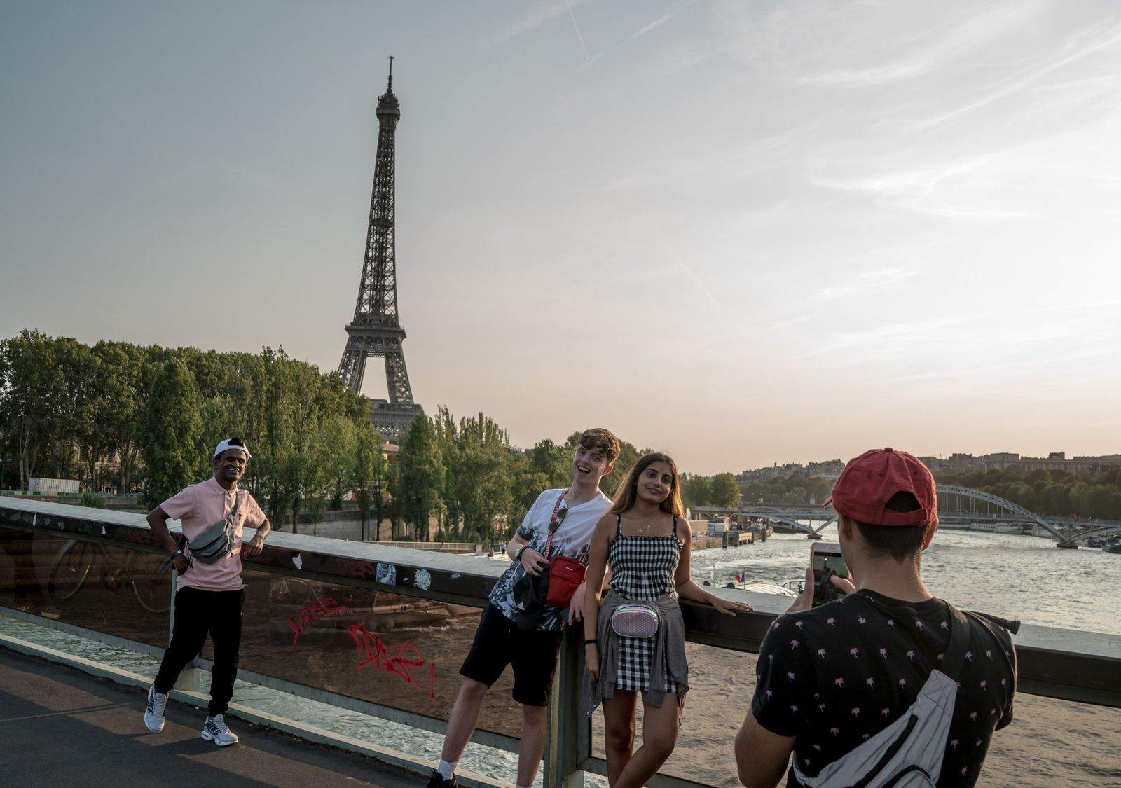 From left: Rakul Sri, Alfie Clarke, Shari Vockrodt and Usman Merchant pose for pictures in front of the Eiffel Tower in Paris.
